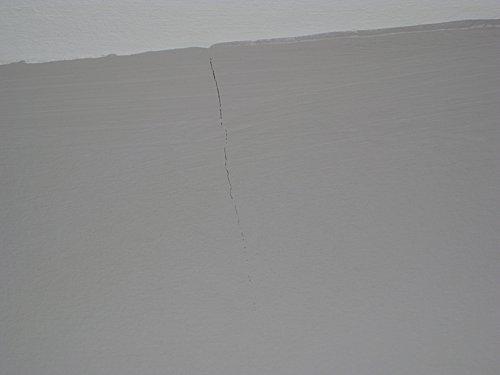 Mur chambre fissure